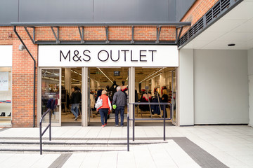 Entrance to M&S Outlet in modern shopping mall