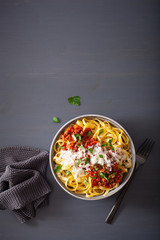 Wall Mural - tagliatelle bolognese with herbs and parmesan, italian pasta