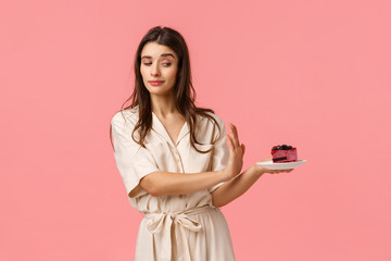 No thank you. Girl having strong will, reject piece cake, holding plate and making stop, refusal...