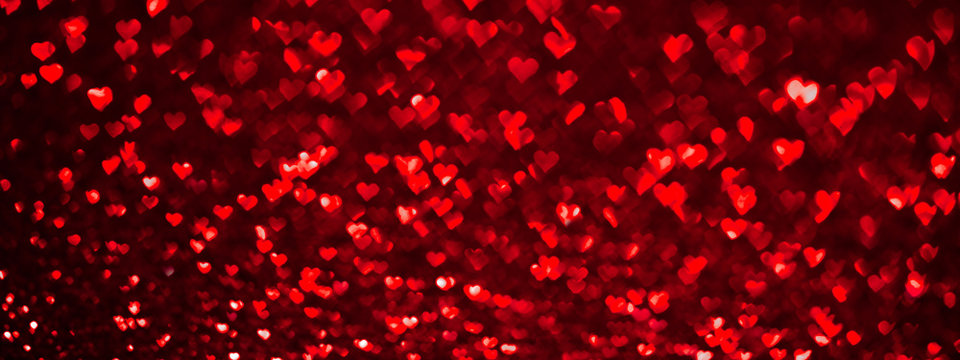 Abstract light, red bokeh pattern in heart shape. St Valentines Day or Holiday concept, background banner image.