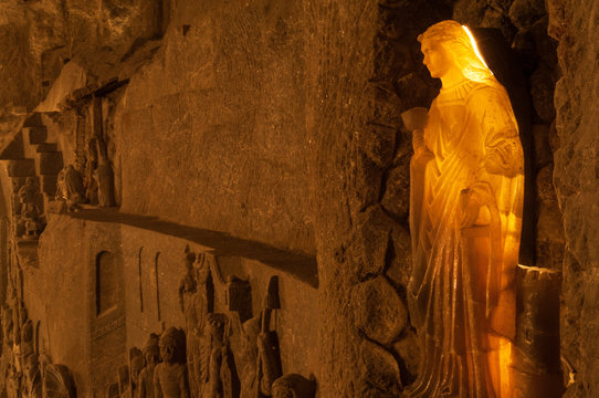 Virgin Mary carved from rock salt inside Wieliczka Salt Mine, a popular tourist destination near Krakow, Poland