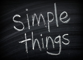 The phrase Simple Things written by hand on a blackboard as a reminder