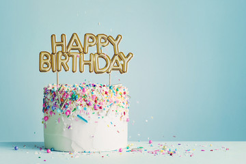 Birthday cake with happy birthday banner Wall mural