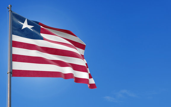 Liberia flag waving in the wind against deep blue sky. National theme, international concept. Copy space for text.