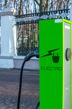 electric vehicle charging station with plug of power cable supply for car. Nfc payment. Selective focus