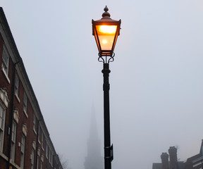 street lamp in front of blue sky