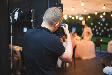 photographer making photos at restaurant Fotobehang
