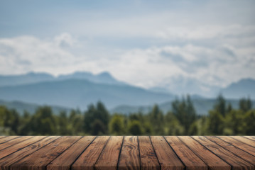 wooden table for advertising with the Alpine mountains in the background Fototapete