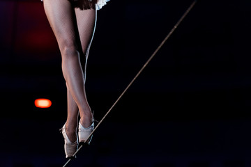 cropped view of aerial acrobat walking on tip toe on rope