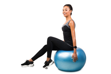 African American Woman Sitting On Fitball Posing Over White Background