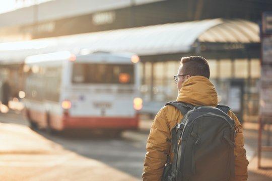 Passenger walking to bus stop