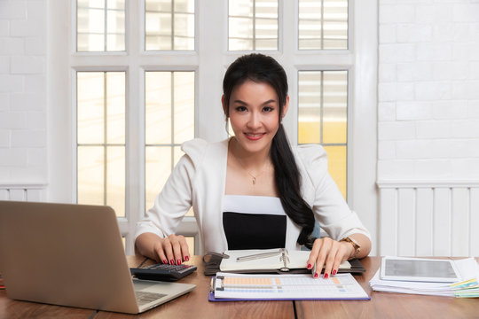 Business woman accountant or banker using calculator in retro office. Savings, finances and economy concept.