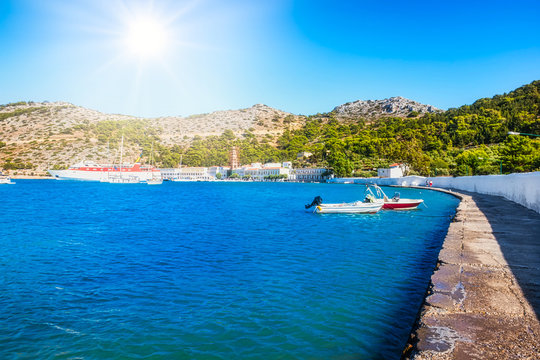 View of bay with boats and Monastery of Taxiarchis Mihail Panormitis on Island of Symi  (Rhodes, Greece)