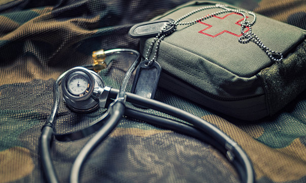 Stethoscope lies on the uniform of a US soldier. The concept of health care, military insurance, state care. Top view.