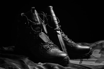 Military boots. The concept of war, veterans, fallen fighters. Sale of military shoes.