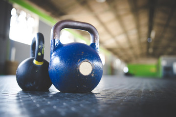 Close up image of kettle bell weights in a gym