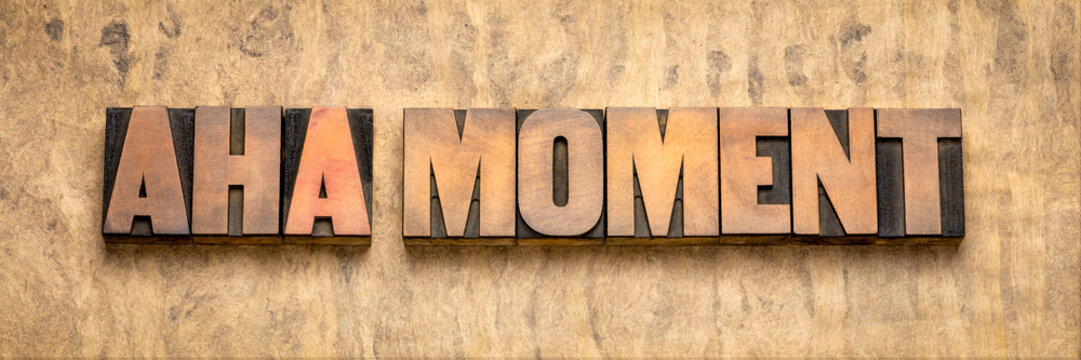 aha moment word abstract in wood type