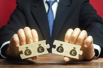 Businessman separates the wooden puzzle with a picture of money. The concept of financial management and distribution of funds. Saving and investing. Property division. Legal services. Fotomurales