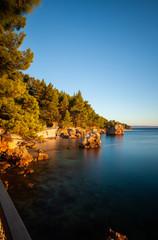 Scenic view of coast against blue sky, Brela, Croatia