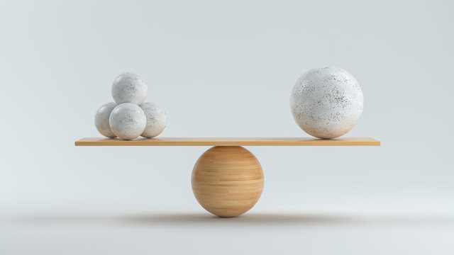 wooden scale balancing one big ball and four small ones