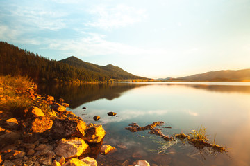 Scenic view of lake with mountains in background, Siberia, Russia
