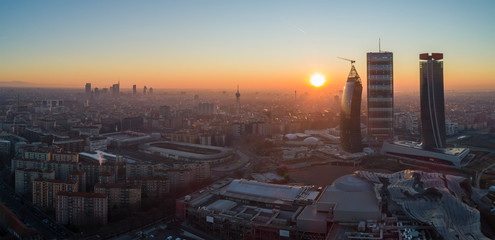 Foto op Plexiglas Milan Milan city skyline at sunrise, aerial view. Panoramic view of new skyscrapers in Citylife district at dawn.