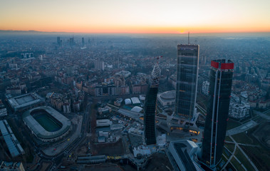 Tuinposter Milan Milan city skyline at sunrise, aerial view. Panoramic view of new skyscrapers in Citylife district at dawn.