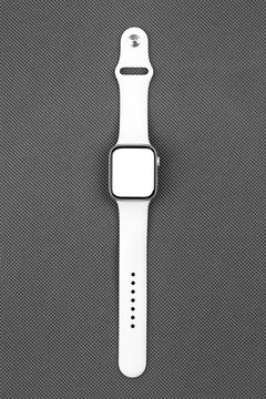 Smart watch with a blank white screen on a gray background.