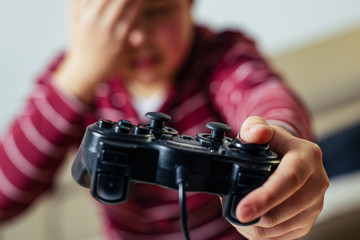 Closeup image of hands holding the game controller.