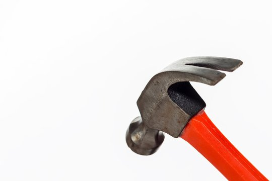 Closeup shot of a red metal hammer isolated on a white background