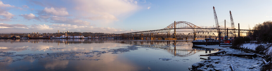 Beautiful Panoramic View of Fraser River and Pattullo Bridge in the City during a cold and icy winter sunset. Taken in New Westminster, Vancouver, British Columbia, Canada. Wall mural
