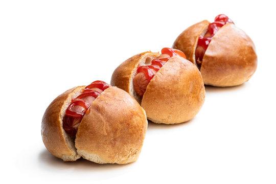 Set of three mini hotdogs isolated on white background