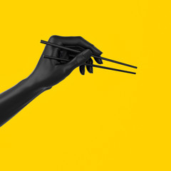 Black hand using chopsticks isolated on yellow, sushi food at Japanese restaurant menu concept 3d illustration.