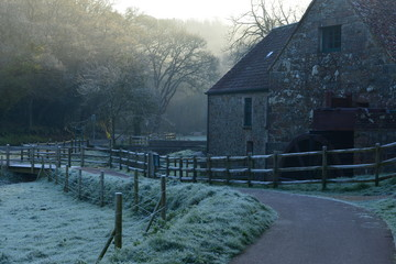 Quetivel Mill, Jersey, U.K. Frosty Winter sunrise at a watermill dated 1309.