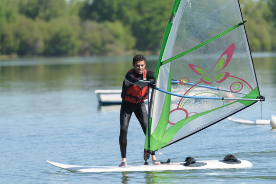a man during wind surfing practice