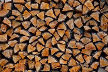 Photo sur Aluminium Texture de bois de chauffage Chopped firewood neatly stacked, texture background