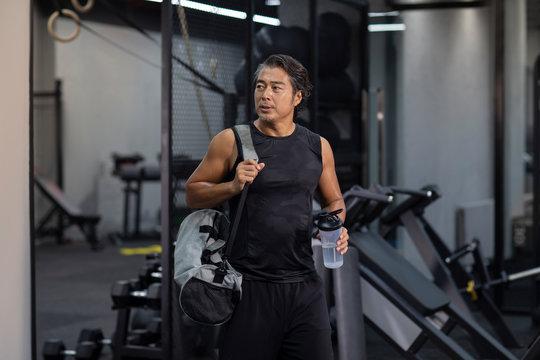 Mature man with gym bag at gym
