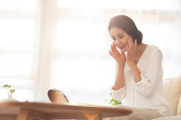 Mature woman and skin care