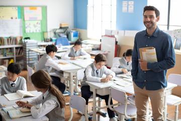 Young teacher teaching a class
