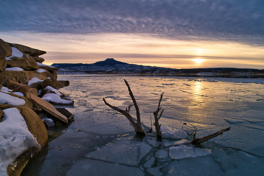 Winter Sunset at Lake Abiquiu in New Mexico with the famous Cerro Pedernal in the Background