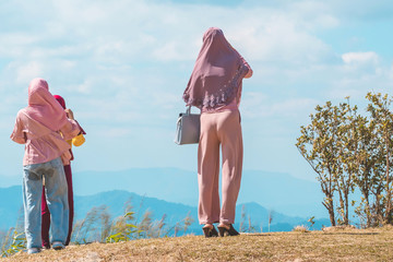 Back view of Muslim women  enjoy on the highest point and the beautiful view landscape in morning at Elephant Hills  View Point are located in Thong Pha Phum Kanchanaburi, Thailand.