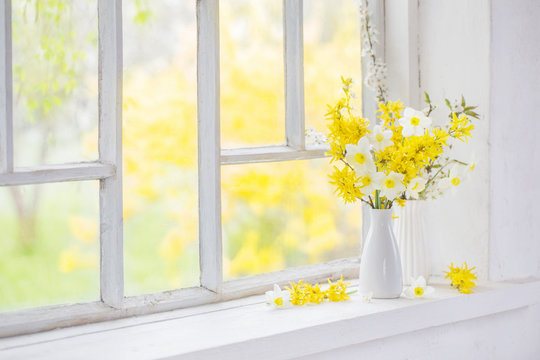 yellow spring flowers on windowsill