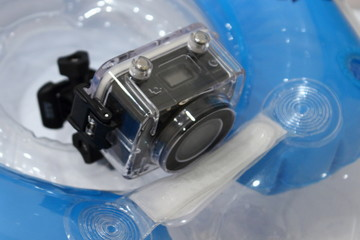 Action camera in waterproof box on a children's inflatable swimming circle, video shooting on the water, in the pool and underwater video