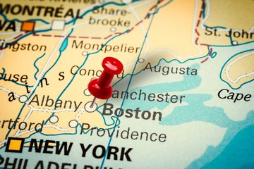Pushpin pointing at Boston city in Massachusetts, America