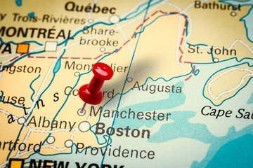 Pushpin pointing at Manchester city in New Hampshire, America