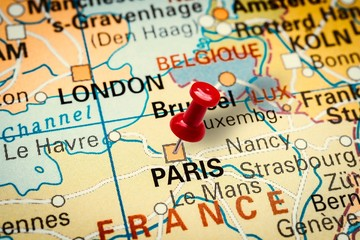 Pushpin pointing at Paris city in France