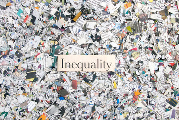 Newspaper confetti from above with the word Inequality