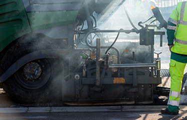 asphalt paver in action