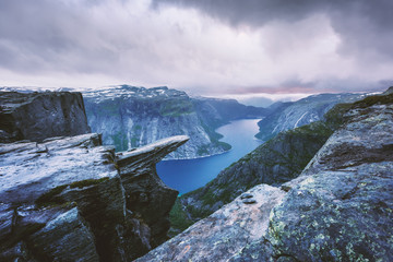 Breathtaking view of Trolltunga rock - most spectacular and famous scenic cliff in Norway. Landscape photography