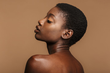 Beauty portrait of young half-naked african woman with short black hair